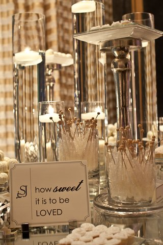white-wedding-candies-on-mirror-table-with-silver-trays