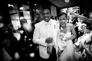 black-and-white-photo-of-bride-and-groom-at-reception-exit