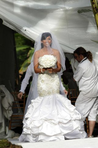 bride-in-a-strapless-form-fitting-gown-with-swarovski-crystals-and-pearls-veil-and-white-bouquet