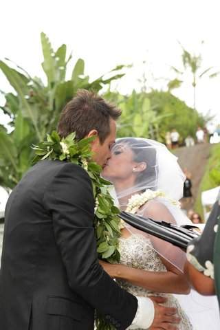 angus-mitchell-co-owner-of-paul-mitchell-systems-kisses-his-bride-at-their-hawaiian-wedding
