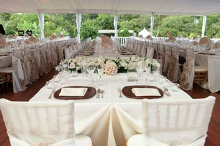 wedding-reception-sweetheart-table-covered-in-white-satin-faces-guest-tables