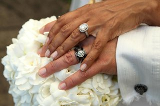 grooms-edgy-wedding-band-with-diamonds-and-brides-pave-engagement-ring-with-a-halo
