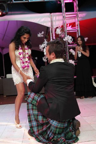 angus-mitchell-co-owner-of-john-mitchell-systems-in-a-kilt-with-his-bride-at-wedding-reception