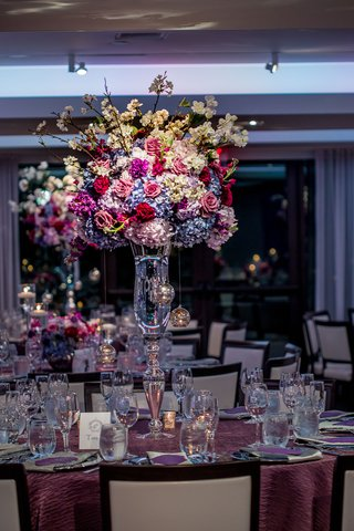 wedding-reception-centerpiece-on-crystal-vase-blue-and-white-hydrangeas-red-and-pink-roses-crysta
