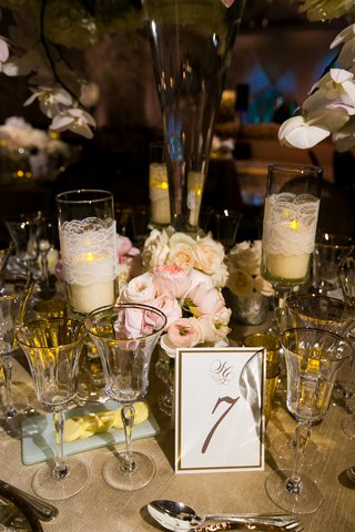 gold-and-white-table-number-at-reception-with-pink-garden-roses