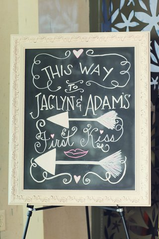 chalkboard-in-white-frame-offers-directions-to-ceremony