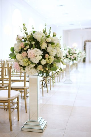 wedding-ceremony-gold-chairs-and-mirror-riser-with-greenery-pink-peony-white-hydrangea-and-roses