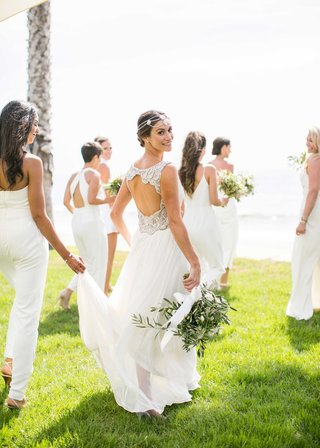 bride-with-keyhole-back-beaded-wedding-dress-headdress-bridesmaids-in-jumpsuits-white