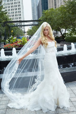 bride-wearing-vera-wang-cathedral-veil-and-gown-in-chicago