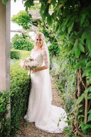 bride-in-oleg-cassini-wedding-dress-in-garden
