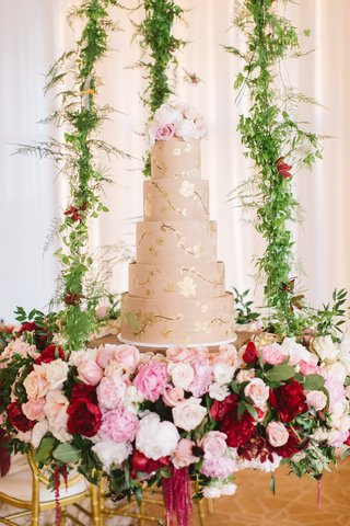 5-five-tier-champagne-hued-cake-floral-chandelier-gold-red-pink-white-greenery-fresh-flowers