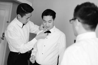 groomsmen-help-groom-tie-bow-tie