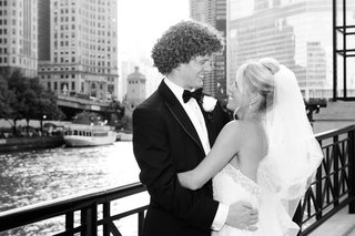 black-and-white-photo-of-newlyweds-gazing-into-each-others-eyes