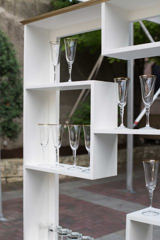 glassware-display-shelf-for-southern-inspired-wedding-white-shelving-unit