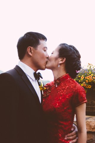 chinese-man-kissing-woman-in-traditonal-red-dress