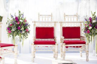 south-asian-wedding-inspiration-red-cushions-on-metallic-chairs-under-mandap