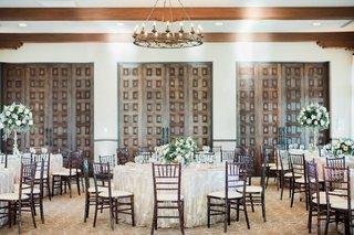 bel-air-bay-club-wedding-reception-ballroom-dark-wood-chairs-doors-high-low-centerpieces-neutral