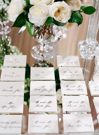 calligraphy-sophisticated-escort-cards-place-settings-on-mirror-table-at-sophisticated-wedding
