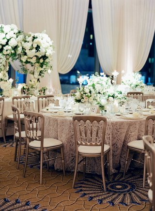 wedding-reception-silver-chairs-around-round-tables-green-and-white-centerpieces-drapery-chicago