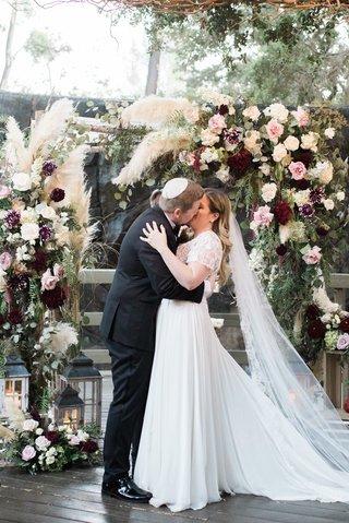 calamigos-ranch-wedding-ceremony-jewish-wedding-groom-in-yarmulke-kissed-bride