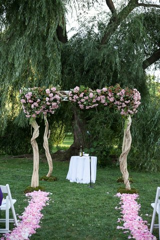 wood-chuppah-with-pink-flowers-under-outdoor-willow-tree