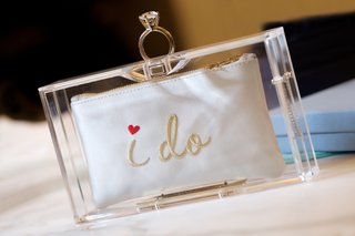 brides-clutch-in-the-form-of-a-clear-box-with-a-white-bag-embroidered-with-the-words-i-do-in-gold
