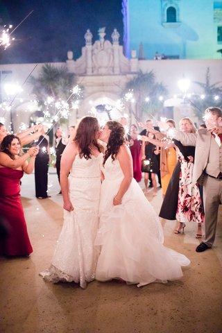 same-sex-wedding-lesbian-wedding-bride-in-winnie-couture-kissing-bride-in-hayley-paige-sparklers