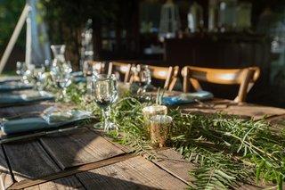 echosmith-singer-sydney-sierota-and-cameron-quiseng-wedding-reception-rustic-reclaimed-wood-table