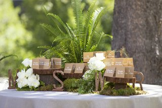 tree-trunk-slabs-topped-with-brown-seating-cards