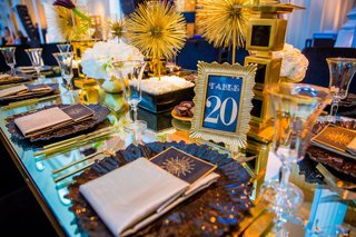 art-deco-inspired-wedding-reception-with-black-and-gold-table-numbers-in-frame
