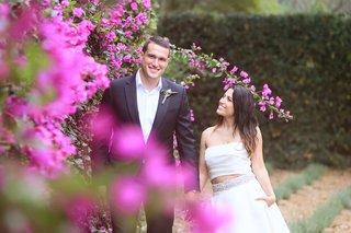bride-in-monique-lhuillier-crop-top-wedding-dress-smiles-with-groom-in-armani