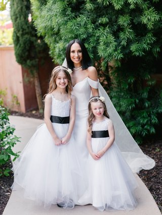 dancing-with-the-stars-cheryl-burke-with-two-flower-girls-white-dresses-black-belt-sash-details