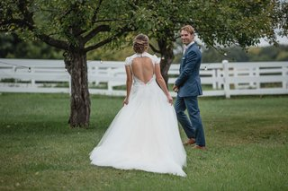 bride-in-keyhole-back-wedding-dress-berta-with-monique-lhuillier-overskirt-blue-suit-for-groom