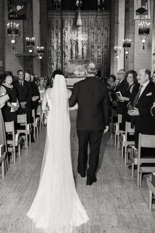 black-and-white-photo-of-father-walking-bride-down-the-aisle-from-the-back