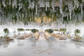wedding-reception-large-white-dance-floor-gold-monogram-with-flower-chandelier-ceiling-installation