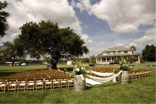 outdoor-wedding-under-tree-at-crossroads-estate