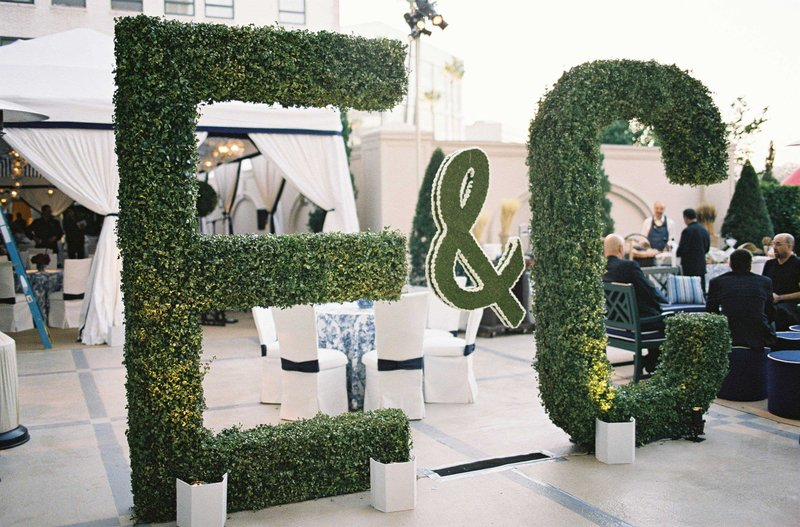 Tall Green Initial Hedges at Wedding