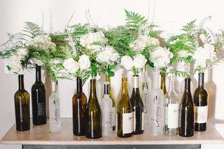wedding-reception-with-ivory-roses-hydrangeas-peonies-greenery-in-robert-mondavi-and-chopin-vodka