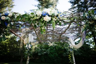 top-of-chuppah-formed-of-woven-branches-and-white-flowers