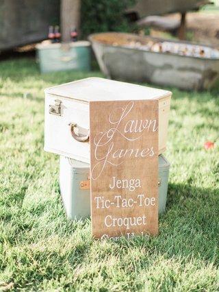 wood-sign-denoting-games-california-boho-chic-wedding-styled-shoot-rustic-fun