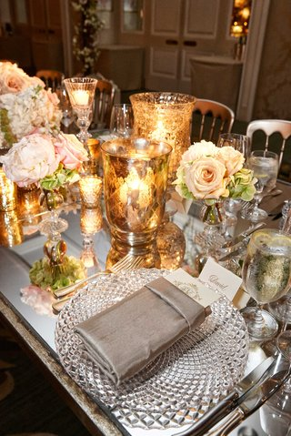 wedding-reception-with-mirror-long-table-white-and-pink-flower-centerpiece-gold-vase-with-candles