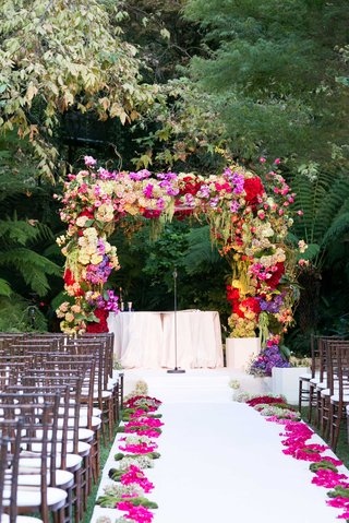 flower-chuppah-at-hotel-bel-air-swan-lake-wedding-ceremony-with-fresh-pomegranate-and-citrus