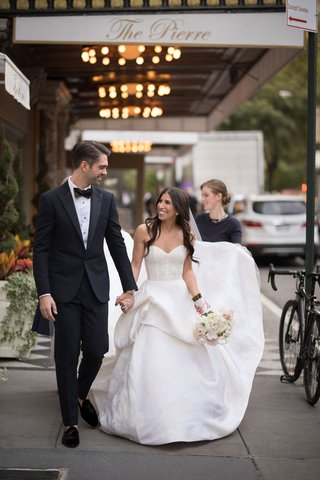 bride-in-strapless-monique-lhuillier-wedding-dress-groom-in-tuxedo-outside-of-the-pierre-in-new-york