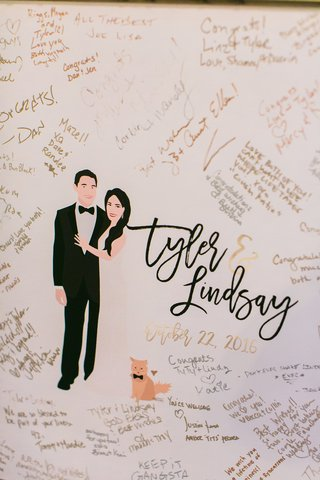 wedding-reception-drawing-of-couple-with-cat-in-bow-tie-and-guest-signatures