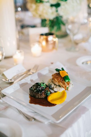 wedding-reception-food-steak-chicken-vegetables-sauces-elegant-dish-entree