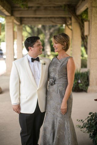 groom-in-white-tuxedo-jacket-black-bow-tie-mother-of-groom-silver-grey-mog-mob-dress