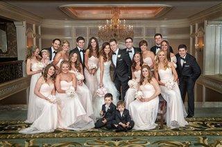 bride-in-vera-wang-wedding-dress-groom-in-tuxedo-groomsmen-bridesmaids-in-pink-dresses
