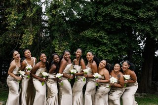 wedding-party-bridesmaids-in-champagne-gold-silk-dresses-with-white-calla-lily-bouquets
