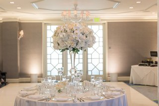 white-wedding-reception-table-with-tall-centerpiece-white-dance-floor