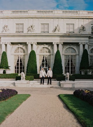 lgbtq-gay-same-sex-wedding-couple-white-tuxedo-in-front-of-rosecliff-mansion-in-newport-rhode-islan